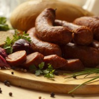 Legg's Smoked Sausage #105 Seasoning produces a ''Southern Style'' smoked sausage with visible, crushed red pepper.
