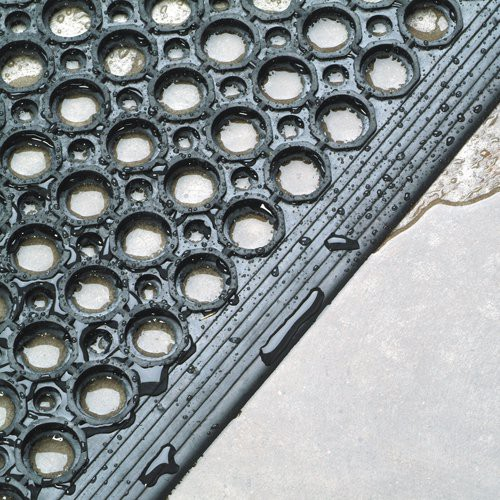 Mat has beveled edges on all sides to prevent tripping and facilitate movement of wheeled carts.