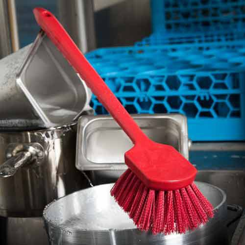 Mixed trim angles on bristles enable superior surface contact and cleaning.